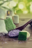 Vintage SPA still life with aromatic burning candles, stones, towel and lavender bath salt Stock Photos