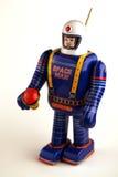 Vintage spaceman tin toy. In blue Stock Photo