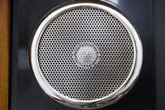 Vintage speaker. In wood panel Royalty Free Stock Photos