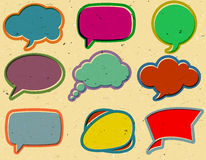 Vintage speech bubbles on the cardboard Royalty Free Stock Photos