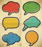 Vintage speech bubbles on the cardboard Royalty Free Stock Images
