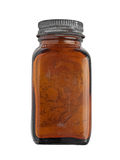Vintage spice bottle. Vintage brown glass spice bottle over white, clipping path Stock Images