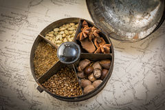 A vintage spice tin on a world map Royalty Free Stock Photography