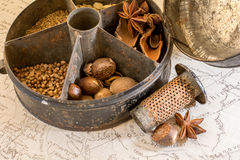 A vintage spice tin on a world map Stock Images