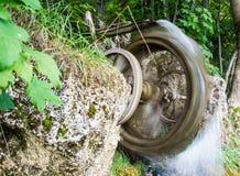 Vintage spinning water wheel Stock Photos