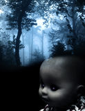 Vintage spooky doll and landscape of foggy forest Royalty Free Stock Photo