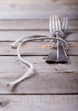 Vintage spoon and forks roped on a wooden table Royalty Free Stock Image