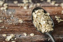 Vintage spoon with oat flakes royalty free stock photos