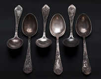 Vintage spoon set #3. Vintage tarnished spoon set on the black background Royalty Free Stock Photo