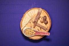 Vintage spoon on a wooden plate with pine nuts stock images