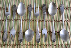 Vintage spoons and forks on bamboo napkin Stock Photos