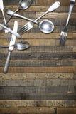 Vintage spoons forks and knives wooden background flat lay instagram mockup