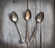 Vintage spoons with patina on wood Royalty Free Stock Images