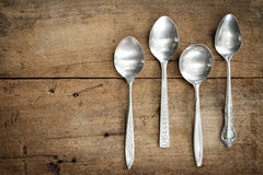 Vintage spoons on wooden background. Stock Image