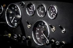 Vintage sports car dashboard. Instruments, switches and gauges on a classic vintage sports car dashboard Stock Image