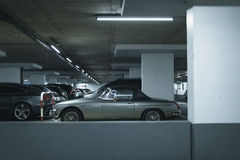 Vintage sports car on parking lot in garage. Royalty Free Stock Photos