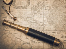 Vintage spyglass and whistle of the boatswain. Stock Images