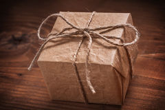 Vintage square gift box with string bow Stock Photos