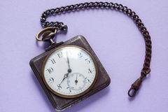 Vintage square watches on lilac Stock Photography