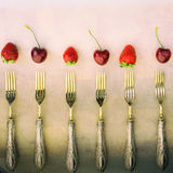 Vintage squared composition with silver forks strawberries annd cherries Royalty Free Stock Image