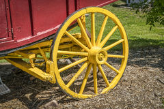 Vintage stagecoach wheel. Vintage wooden stagecoach wheel with a break Stock Photography