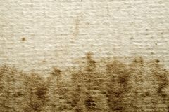 Vintage Stained Textured Paper Background. The texture and stains on this vintage paper provide excellent design elements for any of your projects Stock Photo