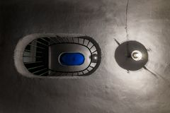 Vintage staircase in a high-rise building and two lamps. Bottom view stock photography