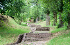 Vintage staircase. Paved with granite slabs rural road in rolling terrain. Peace and tranquility Royalty Free Stock Photo