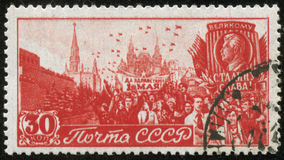 Vintage stamp, macro. SOVIET UNION - CIRCA 1947: A stamp printed by the Soviet Union Post shows May Day demonstration at Red Square in Moscow, circa 1947 Royalty Free Stock Photo