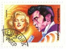 Vintage stamp with  Monroe and Elvis Stock Photos