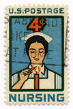 Vintage stamp for nurses. Vintage 1961 stamp dedicated to nurses over white background royalty free stock photo