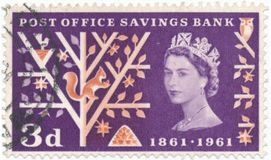 Vintage stamp printed in Great Britain 1961, the 100th Anniversary of the Post Office Savings Bank. POLTAVA, UKRAINE - APRIL 27, 2019. Vintage stamp printed in royalty free stock photo