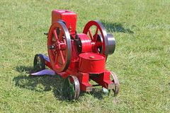 Vintage stationary engine. In a field Royalty Free Stock Photos