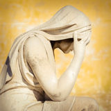 Vintage statue of a crying woman Royalty Free Stock Photography