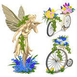 Vintage statue fairies and bikes with flowers Stock Photography