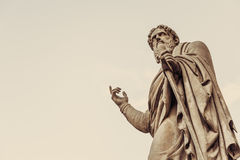 Vintage statue points finger up, copy space for your text Stock Image