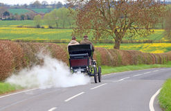 Vintage steam car on a country road. Royalty Free Stock Photo