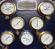 Vintage steam gauges. A panel of vintage steam gauges taken at an old steam driven water pumping station in Brede, Sussex, England Royalty Free Stock Images