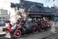 Vintage steam locomotive at the station of Orenburg Stock Photos