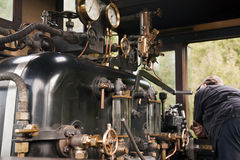 Vintage Steam Train Cab and Driver Stock Photography