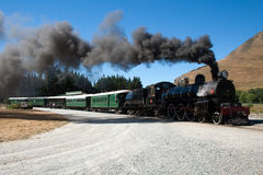 A vintage steam train. Departure in New Zealand outback Royalty Free Stock Image
