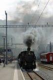 Vintage steam train at Meiringen, Switzerland. Royalty Free Stock Photo