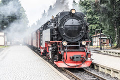 Vintage steam train. Vintage photo of steam train entering a station Royalty Free Stock Image