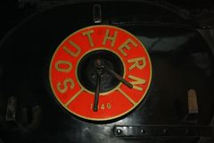 Vintage Steam Train Southern Logo. Red Southern logo on the side of a vintage steam train in the UK Stock Photo