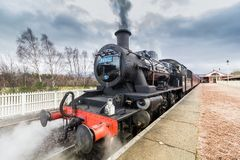 Vintage steam train at station platform royalty free stock photography