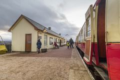 Vintage steam train stopped at rural station royalty free stock photo