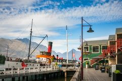 The vintage steamship TSS Earnshow at Queenstowns Wharf. Queenstown, New Zealand -December 23, 2017: Queenstowns pier boutique restaurants and the vintage Royalty Free Stock Photography