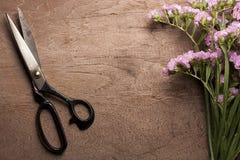 Vintage steel scissors with flower. Royalty Free Stock Image