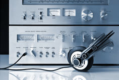 Vintage Stereo Amplifier with Headphones Royalty Free Stock Photos