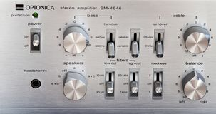Ontario, Canada - December 22 2017: Vintage Stereo Amplifier Shiny Metal Control Knob Panel. Vintage Stereo Amplifier Shiny Metal Control Knob Panel Front view stock images